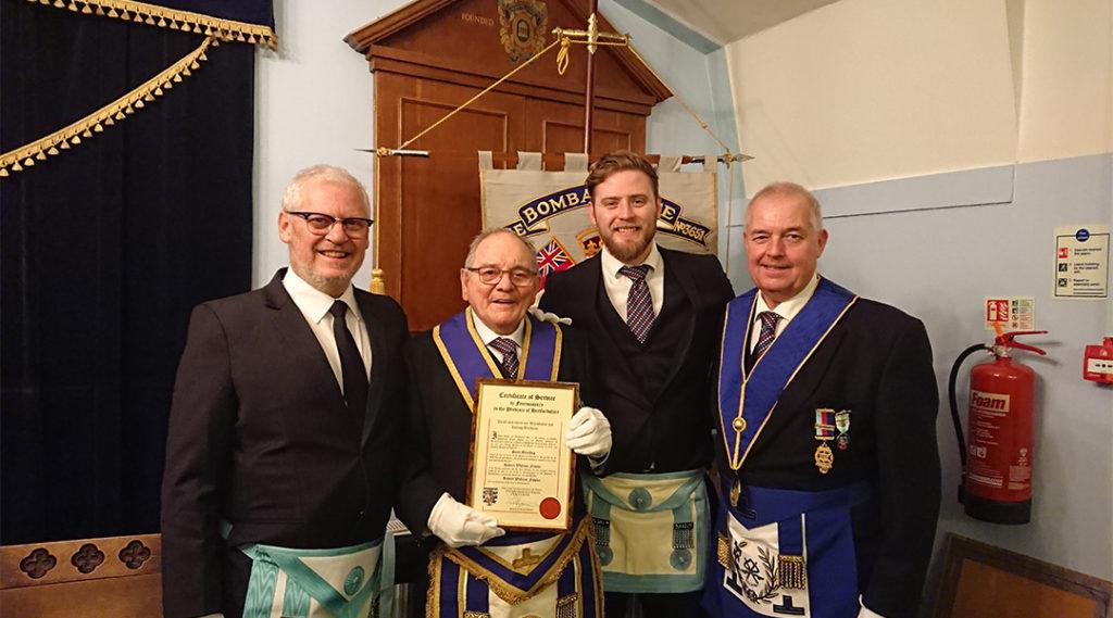 Provincial Grand Almoner, W Bro Simon Cooper, presents W Bro Bob Fowler with the Provincial Grand Master's Certificate of Service