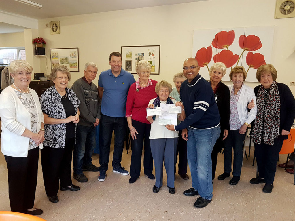 W Bro Darren Sylvester presents a donation to the staff and residents of the Beaumont Centre