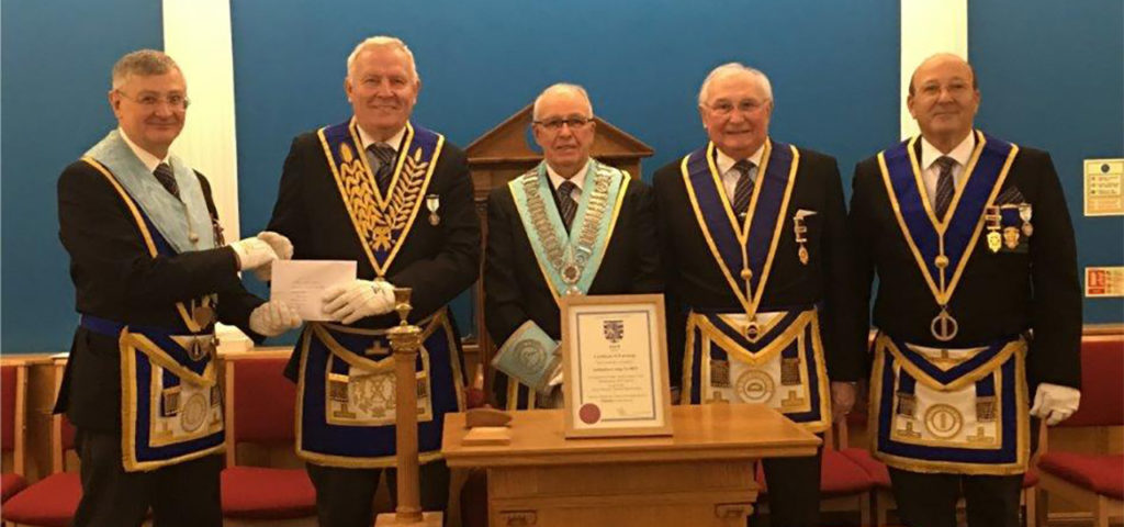 Provincial Grand Charity Steward, Chris Noble congratulates Jubilation Lodge No 8831 on attaining 'Vice Patron' status for the 2019 Festival