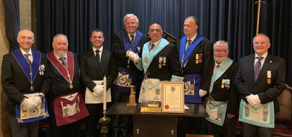 Provincial Grand Charity Steward, W Bro Chris Noble present Prince Hamlet Lodge No 9864 with a certificate of Patronage for the 2019 Festival