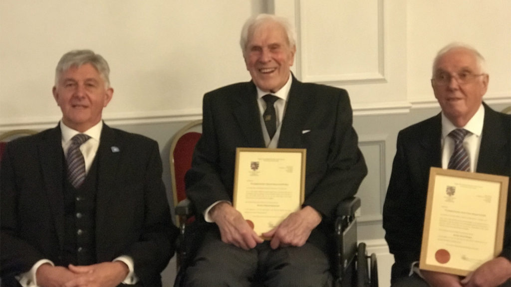 Provincial Grand Master, Paul Gower presents W Bros Derek Burgess and Edmund Homewood with Certificates of Service