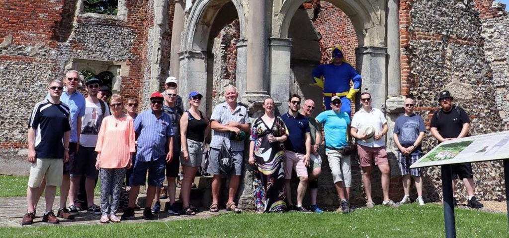 Members of the Fleet House Light Blues Club and their guests stands in front of the ruins of old Gorehambury House in St Albans