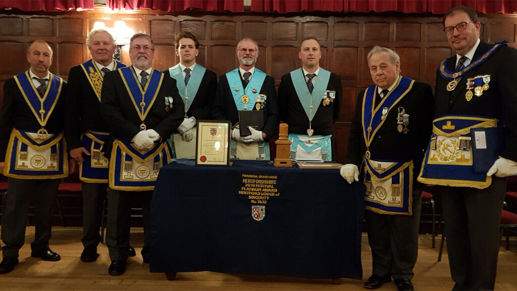 Assistant Provincial Grand Master, John Norris with the members of Herutforda Lodge of Sincerity No 7632