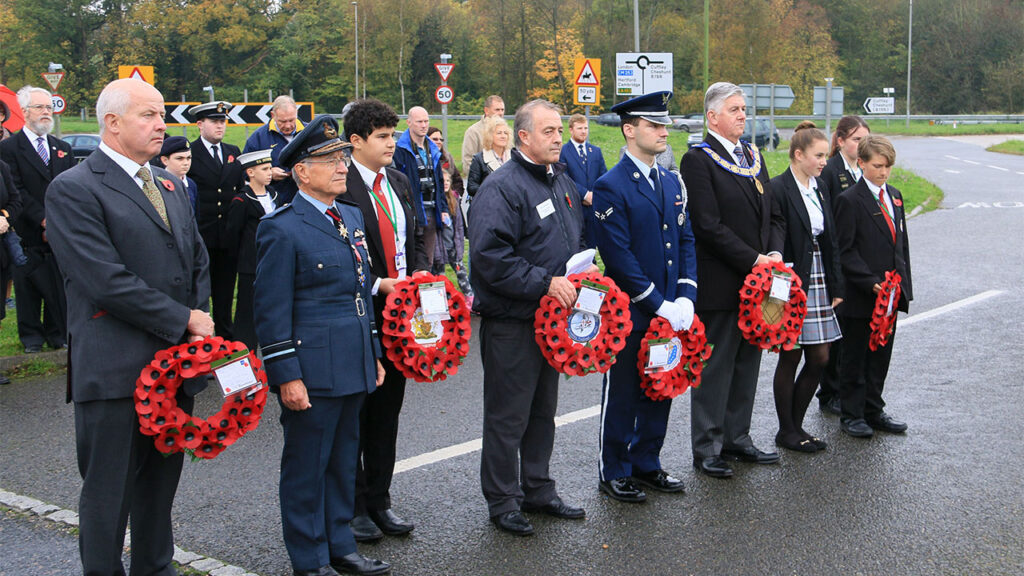 Members of the military, the Provincial Grand Master and local school children lay wreaths at the Liberator Memorial
