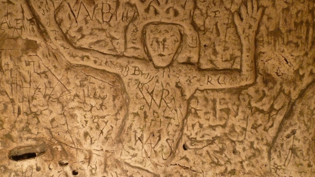 Graffiti on the walls of Royston Cave contains mysterious symbols whose meaning is often unclear