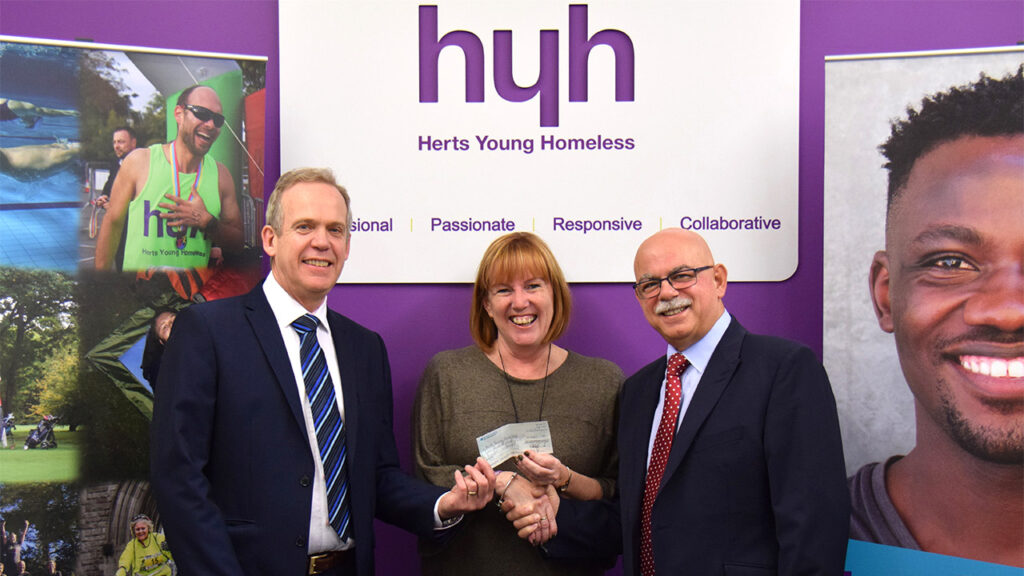 Tony Reffold and Ali Osman present the Herts Young Homeless with a cheque for £465