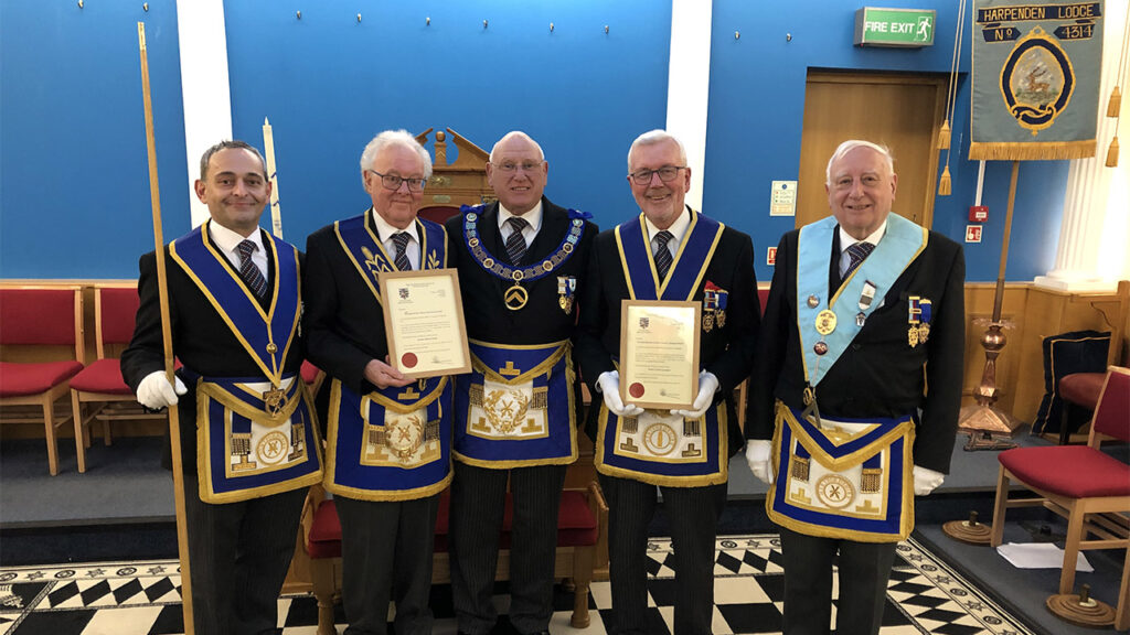 Deputy Provincial Grand Master, Dick Knifton presents W Bros Gerry Greenland and Mike Imeson with their 50-year Certificates