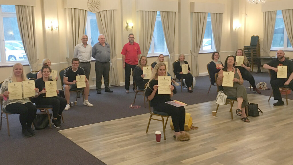 Participants on the Emergency First Aid at Work course proudly show off their certificates
